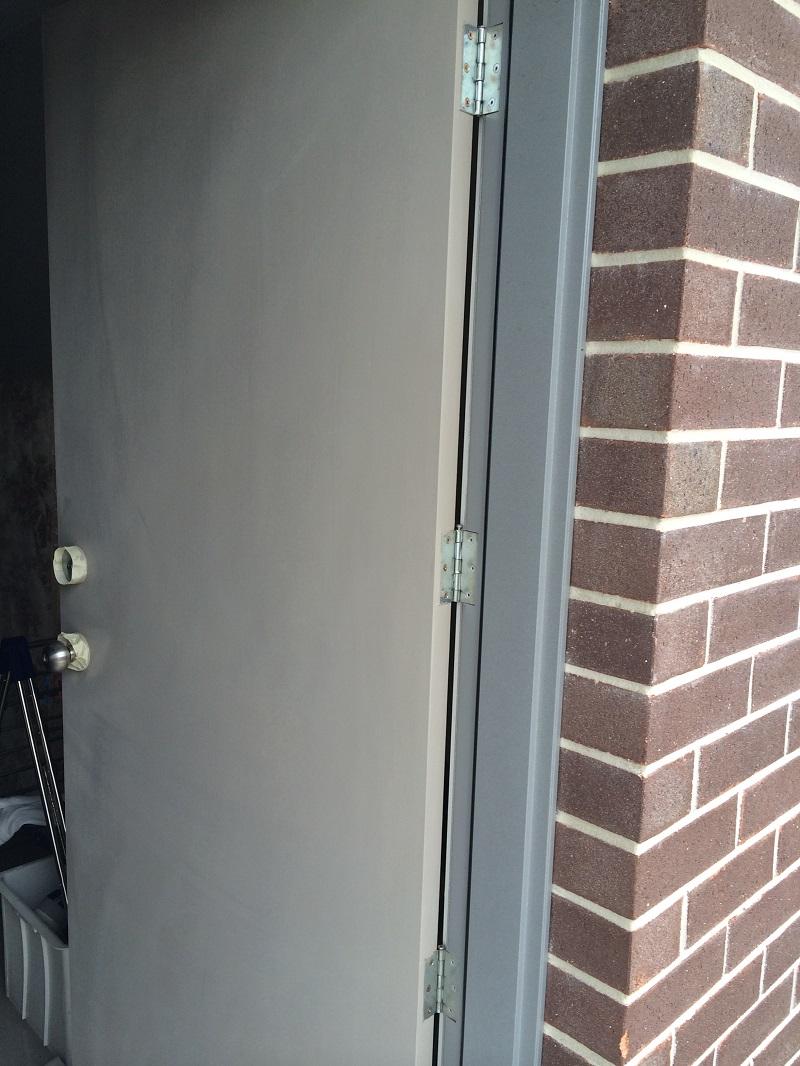Repaint of external door (before)