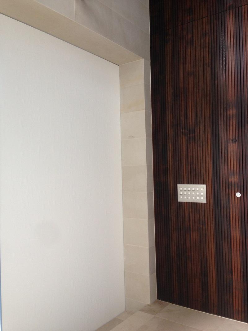 Wallpaper feature on cavity door